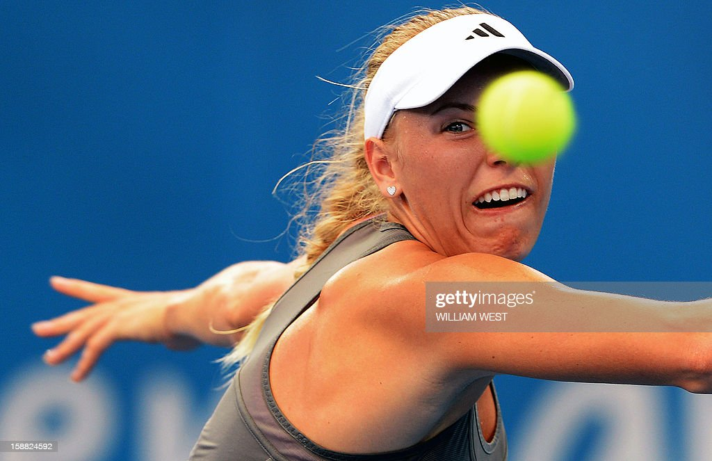 Caroline Wozniacki of Denmark keeps her eye on the ball in her match against Ksenia Pervak of Kazakhstan in the first round at the Brisbane International tennis tournament on December 31, 2012. AFP PHOTO/William WEST IMAGE