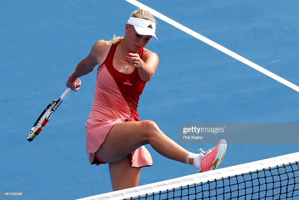 Caroline Wozniacki of Denmark kicks the net during her semifinal match against Barbora Zahlavova Strycova of the Czech Republic during day five of...