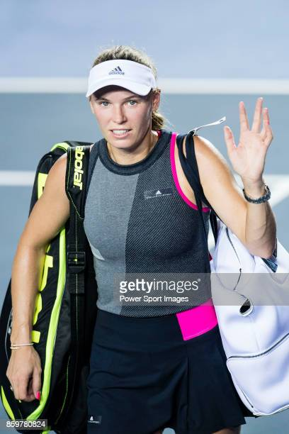 Caroline Wozniacki of Denmark leaves the court after defeating Eugenie Bouchard during the Prudential Hong Kong Tennis Open 2017 match between...