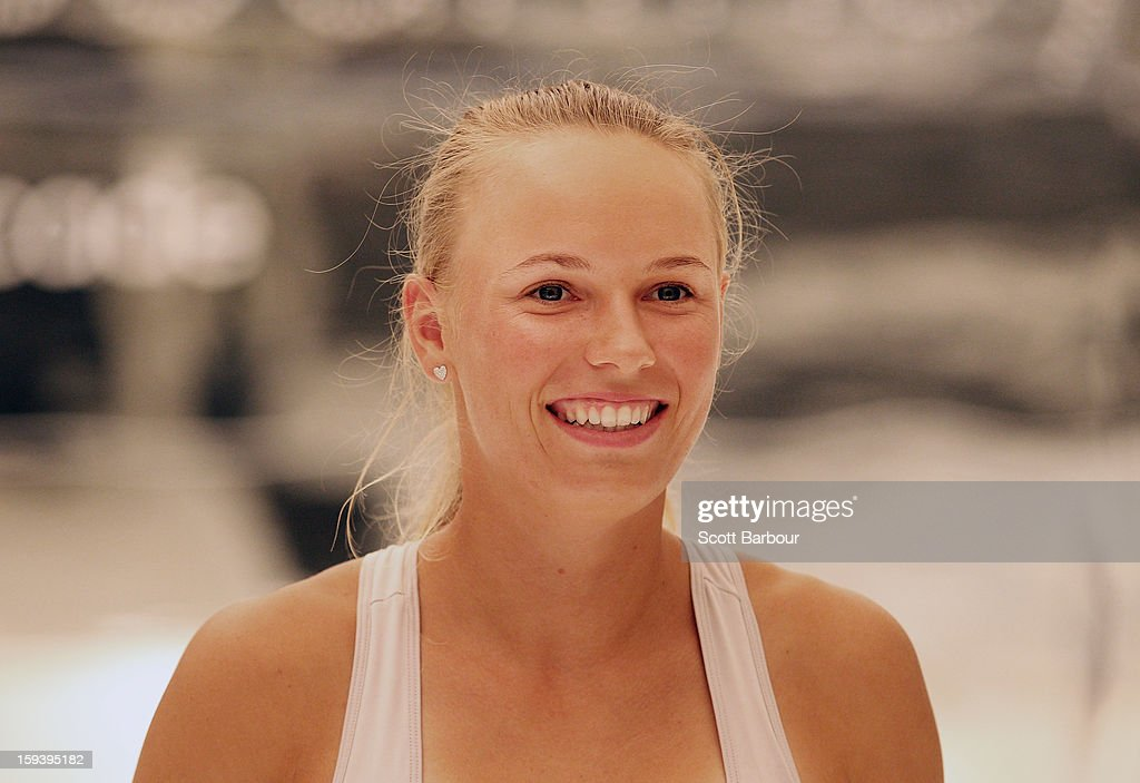 Caroline Wozniacki of Denmark looks on during the Adidas by Stella McCartney media launch on January 13, 2013 in Melbourne, Australia. To globally launch the first adidas by Stella McCartney collection tennis players Caroline Wozniacki, Maria Kirilenko and Laura Robson played tennis in the world's first mirror court.