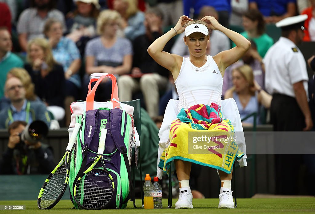 <a gi-track='captionPersonalityLinkClicked' href=/galleries/search?phrase=Caroline+Wozniacki&family=editorial&specificpeople=740679 ng-click='$event.stopPropagation()'>Caroline Wozniacki</a> of Denmark looks on following defeat during the Ladies Singles first round match against Svetlana Kuznetsova of Russia on day two of the Wimbledon Lawn Tennis Championships at the All England Lawn Tennis and Croquet Club on June 28, 2016 in London, England.