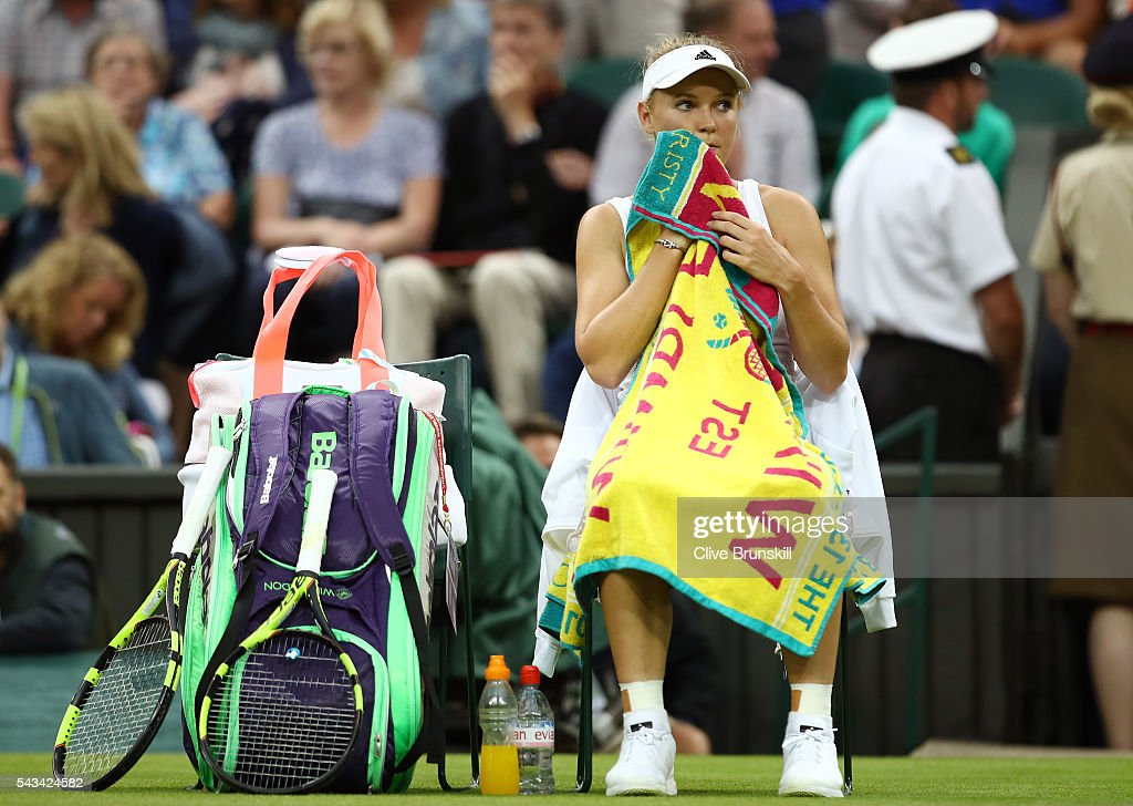 Caroline Wozniacki of Denmark looks on following defeat during the Ladies Singles first round match against Svetlana Kuznetsova of Russia on day two of the Wimbledon Lawn Tennis Championships at the All England Lawn Tennis and Croquet Club on June 28, 2016 in London, England.