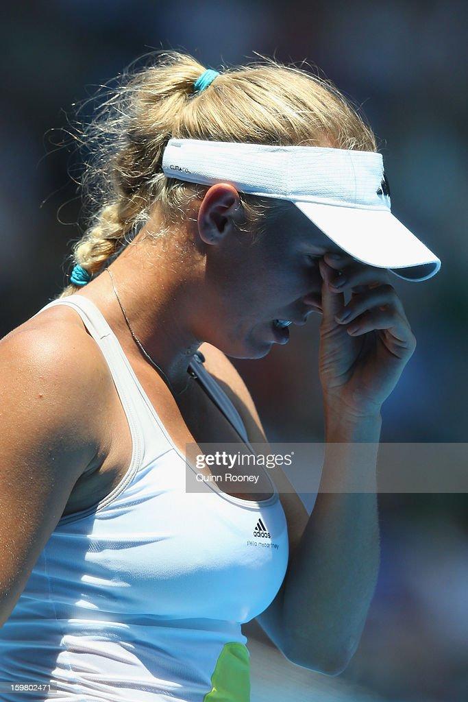 Caroline Wozniacki of Denmark looks on in her fourth round match against Svetlana Kuznetsova of Russia during day eight of the 2013 Australian Open at Melbourne Park on January 21, 2013 in Melbourne, Australia.