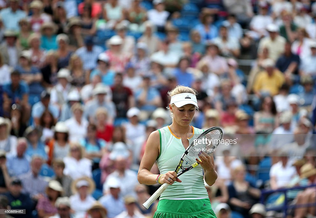 Caroline Wozniacki of Denmark looks on in her singles match with Camila Giorgi of Italy on day six of the Aegon International at Devonshire Park on June 19, 2014 in Eastbourne, England.