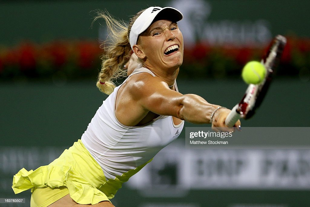 <a gi-track='captionPersonalityLinkClicked' href=/galleries/search?phrase=Caroline+Wozniacki&family=editorial&specificpeople=740679 ng-click='$event.stopPropagation()'>Caroline Wozniacki</a> of Denmark lunges for a shot while playing Angelique Kerber during the BNP Paribas Open at the Indian Wells Tennis Garden on March 15, 2013 in Indian Wells, California.