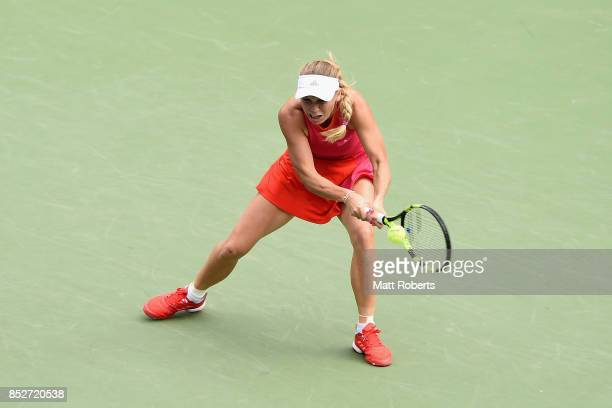 Caroline Wozniacki of Denmark plays a backhand against Anastasia Pavlyuchenkova of Russia during the women's singles final match on day seven of the...