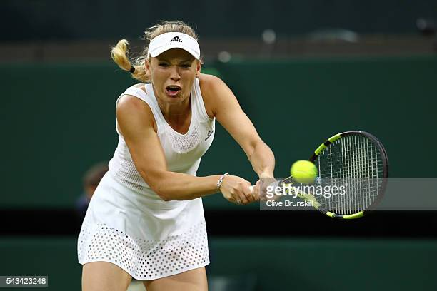 Caroline Wozniacki of Denmark plays a backhand during the Ladies Singles first round match against Svetlana Kuznetsova of Russia on day two of the...