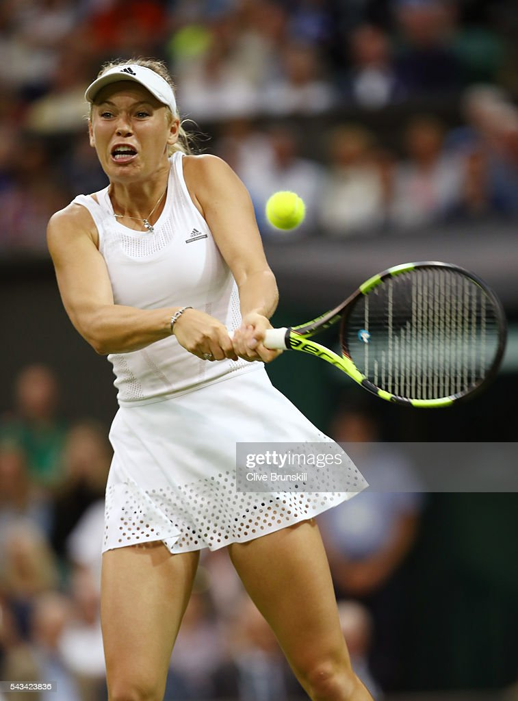 Caroline Wozniacki of Denmark plays a backhand during the Ladies Singles first round match against Svetlana Kuznetsova of Russia on day two of the Wimbledon Lawn Tennis Championships at the All England Lawn Tennis and Croquet Club on June 28, 2016 in London, England.