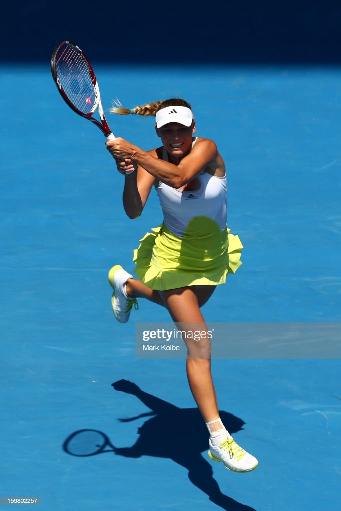 Caroline Wozniacki of Denmark plays a backhand in her fourth round match against Svetlana Kuznetsova of Russia during day eight of the 2013 Australian Open at Melbourne Park on January 21, 2013 in Melbourne, Australia.