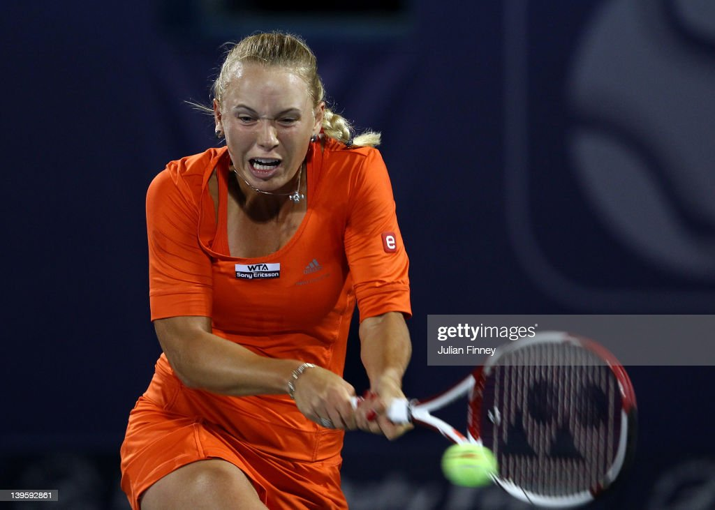 <a gi-track='captionPersonalityLinkClicked' href=/galleries/search?phrase=Caroline+Wozniacki&family=editorial&specificpeople=740679 ng-click='$event.stopPropagation()'>Caroline Wozniacki</a> of Denmark plays a backhand in her match against Ana Ivanovic of Serbia during day four of the WTA Dubai Duty Free Tennis Championship on February 23, 2012 in Dubai, United Arab Emirates.