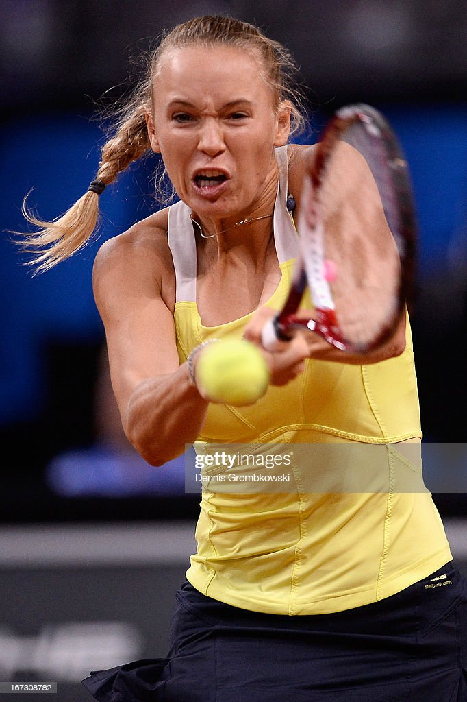 <a gi-track='captionPersonalityLinkClicked' href=/galleries/search?phrase=Caroline+Wozniacki&family=editorial&specificpeople=740679 ng-click='$event.stopPropagation()'>Caroline Wozniacki</a> of Denmark plays a backhand in her match against Carla Suarez Navarro of Spain during Day 3 of the Porsche Tennis Grand Prix at Porsche-Arena on April 24, 2013 in Stuttgart, Germany.