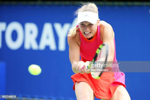 Caroline Wozniacki of Denmark plays a backhand in her match against Anastasia Pavlyuchenkova of Russia during the women's singles final match during...
