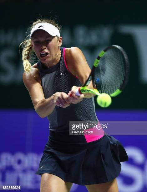 Caroline Wozniacki of Denmark plays a backhand in her singles semi final match against Karolina Pliskova of Czech Republic during day 7 of the BNP...