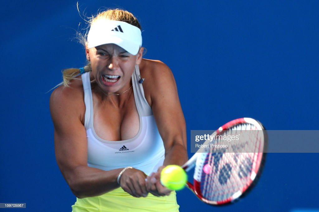 Caroline Wozniacki of Denmark plays a backhand in her third round match against Lesia Tsurenko of the Ukraine during day six of the 2013 Australian Open at Melbourne Park on January 19, 2013 in Melbourne, Australia.