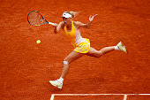 Caroline Wozniacki of Denmark plays a forehand during her women's singles match against Karin Knapp of Italy on day three of the 2015 French Open at...