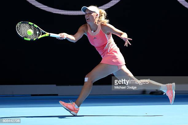 Caroline Wozniacki of Denmark plays a forehand in her first round match against Yulia Putintseva of Kazakhstan during day one of the 2016 Australian...