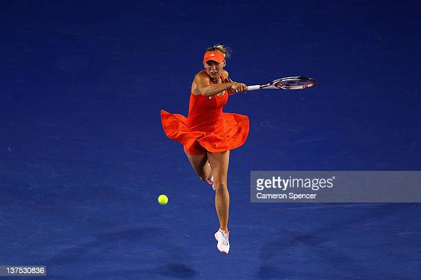 Caroline Wozniacki of Denmark plays a forehand in her fourth round match against Jelena Jankovic of Serbia during day seven of the 2012 Australian...