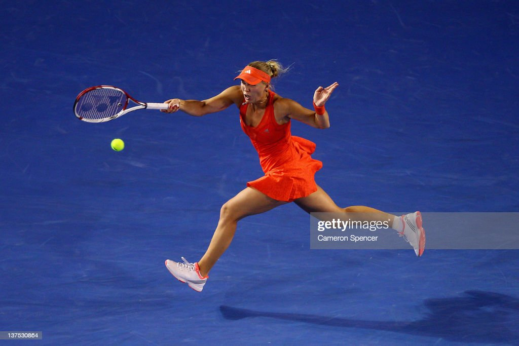 <a gi-track='captionPersonalityLinkClicked' href=/galleries/search?phrase=Caroline+Wozniacki&family=editorial&specificpeople=740679 ng-click='$event.stopPropagation()'>Caroline Wozniacki</a> of Denmark plays a forehand in her fourth round match against Jelena Jankovic of Serbia during day seven of the 2012 Australian Open at Melbourne Park on January 22, 2012 in Melbourne, Australia.