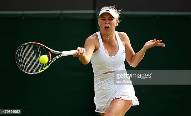 Caroline Wozniacki of Denmark plays a forehand in her Ladies' Singles Fourth Round match against Garbine Muguruza of Spain during day seven of the...