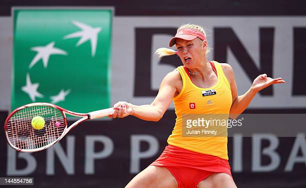 Caroline Wozniacki of Denmark plays a forehand in her match against Anabel Medina Garrigues of Spain during day five of the Internazionali BNL...