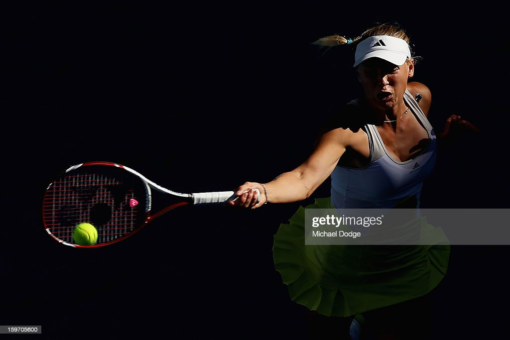 <a gi-track='captionPersonalityLinkClicked' href=/galleries/search?phrase=Caroline+Wozniacki&family=editorial&specificpeople=740679 ng-click='$event.stopPropagation()'>Caroline Wozniacki</a> of Denmark plays a forehand in her third round match against Lesia Tsurenko of the Ukraine during day six of the 2013 Australian Open at Melbourne Park on January 19, 2013 in Melbourne, Australia.