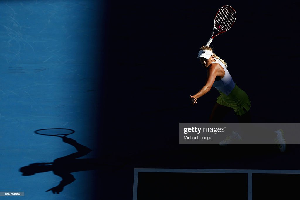 Caroline Wozniacki of Denmark plays a forehand in her third round match against Lesia Tsurenko of the Ukraine during day six of the 2013 Australian Open at Melbourne Park on January 19, 2013 in Melbourne, Australia.