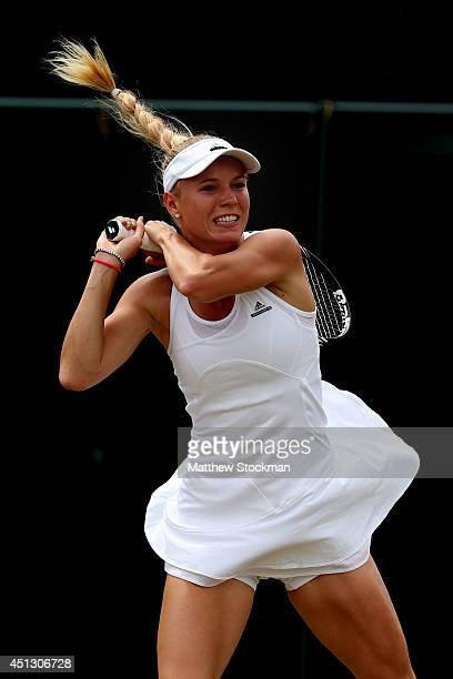 Caroline Wozniacki of Denmark plays a forehand return during the Ladies' Singles third round match against Ana Konjuh of Croatia on day five of the...