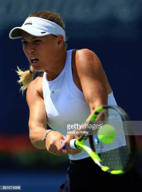 Caroline Wozniacki of Denmark plays a shot against Elina Svitolina of Ukraine during the final match on Day 9 of the Rogers Cup at Aviva Centre on...