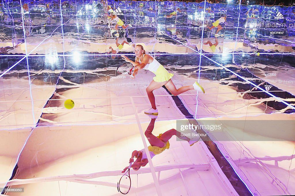 Caroline Wozniacki of Denmark plays a shot on a mirror court at the Adidas by Stella McCartney media launch on January 13, 2013 in Melbourne, Australia. To globally launch the first adidas by Stella McCartney collection tennis players Caroline Wozniacki, Maria Kirilenko and Laura Robson played tennis in the world's first mirror court.