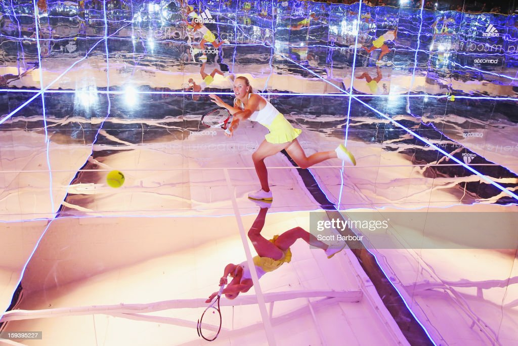 <a gi-track='captionPersonalityLinkClicked' href=/galleries/search?phrase=Caroline+Wozniacki&family=editorial&specificpeople=740679 ng-click='$event.stopPropagation()'>Caroline Wozniacki</a> of Denmark plays a shot on a mirror court at the Adidas by Stella McCartney media launch on January 13, 2013 in Melbourne, Australia. To globally launch the first adidas by Stella McCartney collection tennis players <a gi-track='captionPersonalityLinkClicked' href=/galleries/search?phrase=Caroline+Wozniacki&family=editorial&specificpeople=740679 ng-click='$event.stopPropagation()'>Caroline Wozniacki</a>, Maria Kirilenko and Laura Robson played tennis in the world's first mirror court.