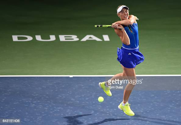 Caroline Wozniacki of Denmark plays backhand during her match against Daria Kasatkina of Russia on day two of the WTA Dubai Duty Free Tennis...