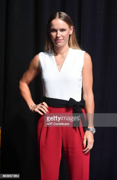 Caroline Wozniacki of Denmark poses for photographers during the Official Draw Ceremony of the WTA Finals Singapore on October 20 2017 The WTA Finals...