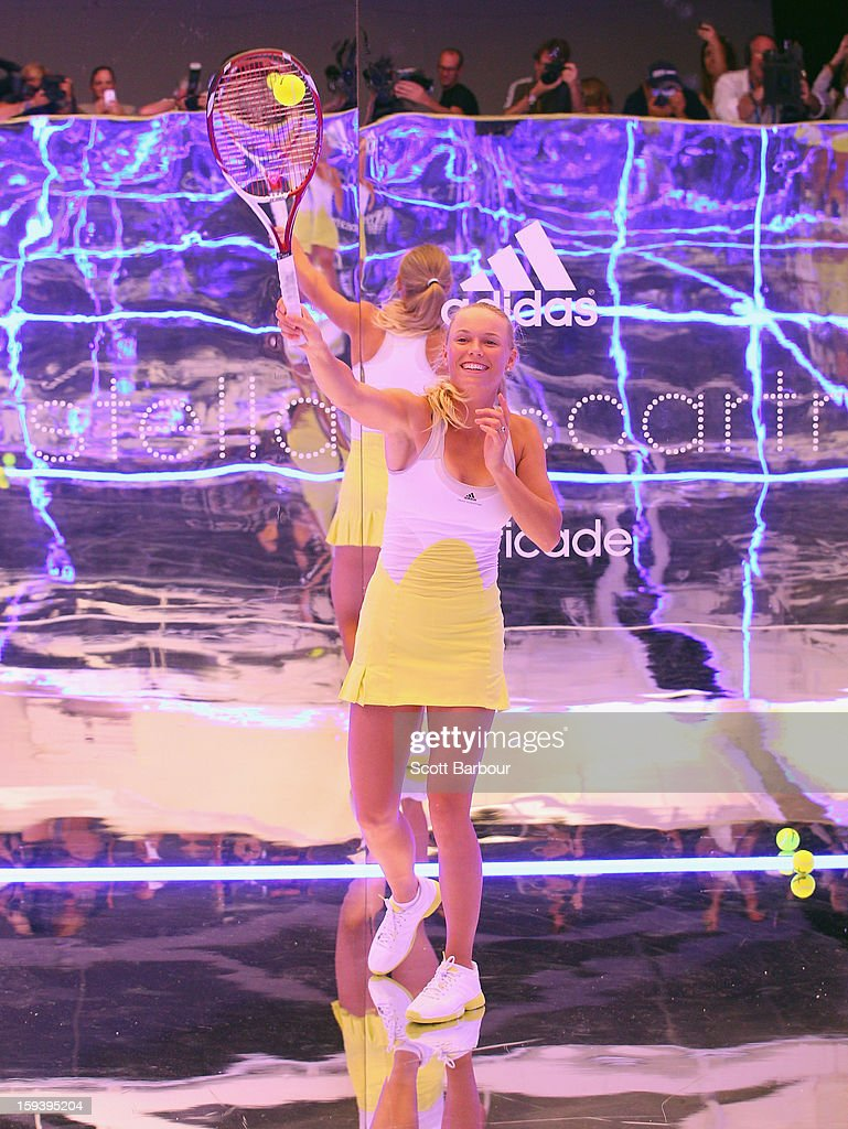 Caroline Wozniacki of Denmark poses on a mirror court at the Adidas by Stella McCartney media launch on January 13, 2013 in Melbourne, Australia. To globally launch the first adidas by Stella McCartney collection tennis players Caroline Wozniacki, Maria Kirilenko and Laura Robson played tennis in the world's first mirror court.