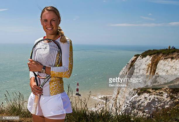 Caroline Wozniacki of Denmark poses on top of Beachy Head at on June 21 2015 in Eastbourne England