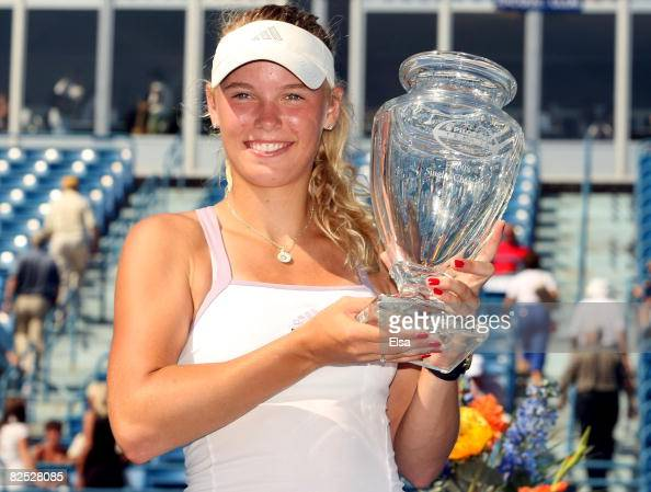 Caroline Wozniacki of Denmark poses with her championship trophy after she defeated Anna Chakvetadze of Russia during the women's singles...