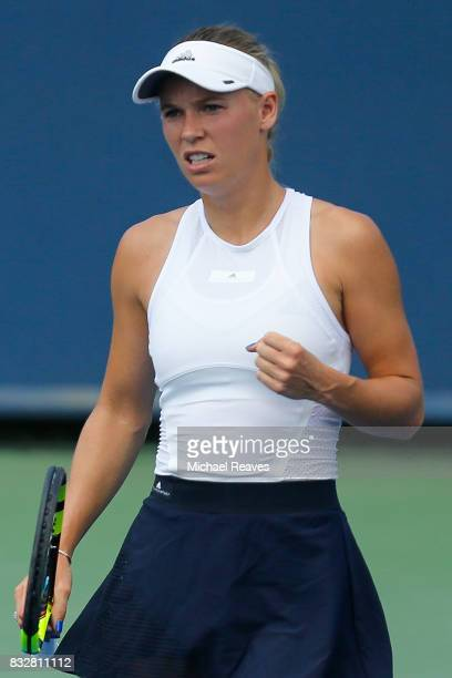 Caroline Wozniacki of Denmark reacts after a point against Elena Vesnina of Russia during Day 5 of the Western and Southern Open at the Lindner...