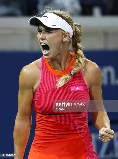 Caroline Wozniacki of Denmark reacts against Ekaterina Makarova of Russia during their second round Women's Singles match on Day Three of the 2017 US...
