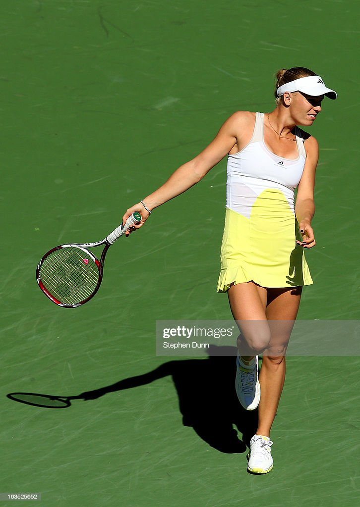 Caroline Wozniacki of Denmark reacts as she watches her shot to Elena Vesnina of Russia during day 6 of the BNP Paribas Open at Indian Wells Tennis Garden on March 11, 2013 in Indian Wells, California. (Photo by Stephen Dunn/Getty Images).