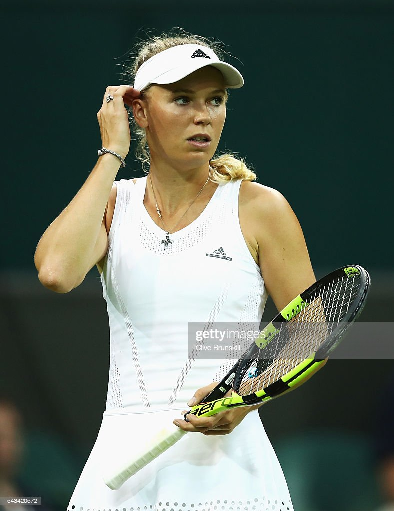 <a gi-track='captionPersonalityLinkClicked' href=/galleries/search?phrase=Caroline+Wozniacki&family=editorial&specificpeople=740679 ng-click='$event.stopPropagation()'>Caroline Wozniacki</a> of Denmark reacts during the Ladies Singles first round match against Svetlana Kuznetsova of Russia on day two of the Wimbledon Lawn Tennis Championships at the All England Lawn Tennis and Croquet Club on June 28, 2016 in London, England.