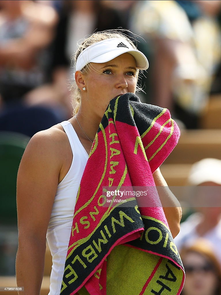 <a gi-track='captionPersonalityLinkClicked' href=/galleries/search?phrase=Caroline+Wozniacki&family=editorial&specificpeople=740679 ng-click='$event.stopPropagation()'>Caroline Wozniacki</a> of Denmark reacts in her Ladies' Singles Fourth Round match against Garbine Muguruza of Spain during day seven of the Wimbledon Lawn Tennis Championships at the All England Lawn Tennis and Croquet Club on July 6, 2015 in London, England.