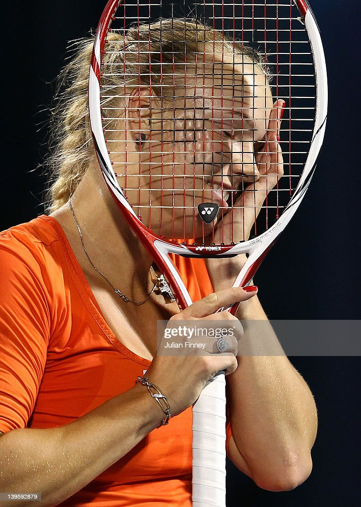 <a gi-track='captionPersonalityLinkClicked' href=/galleries/search?phrase=Caroline+Wozniacki&family=editorial&specificpeople=740679 ng-click='$event.stopPropagation()'>Caroline Wozniacki</a> of Denmark reacts in her match against Ana Ivanovic of Serbia during day four of the WTA Dubai Duty Free Tennis Championship on February 23, 2012 in Dubai, United Arab Emirates.