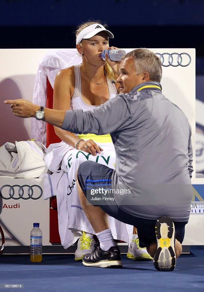 <a gi-track='captionPersonalityLinkClicked' href=/galleries/search?phrase=Caroline+Wozniacki&family=editorial&specificpeople=740679 ng-click='$event.stopPropagation()'>Caroline Wozniacki</a> of Denmark receives advice from her father and coach Piotr Wozniacki in her match against Lucie Safarova of Czech Republic during day two of the WTA Dubai Duty Free Tennis Championship on February 19, 2013 in Dubai, United Arab Emirates.