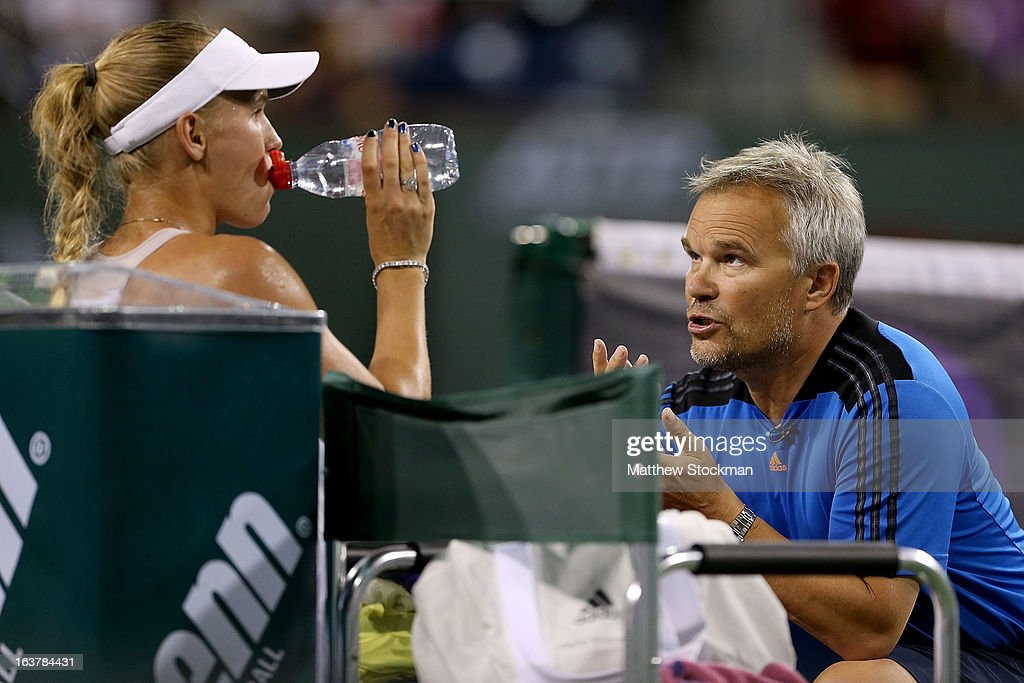 Caroline Wozniacki of Denmark receives coaching from her father Piotr Wozniacki while playing Angelique Kerber of Germany during the BNP Paribas Open at the Indian Wells Tennis Garden on March 15, 2013 in Indian Wells, California.