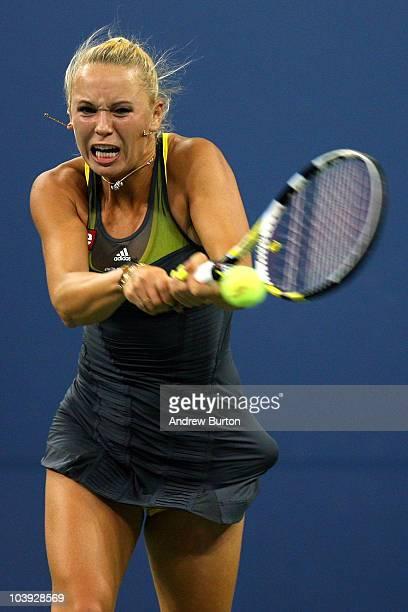 Caroline Wozniacki of Denmark returns a shot against Dominika Cibulkova of Slovakia during her women's single quarterfinal match during day ten of...