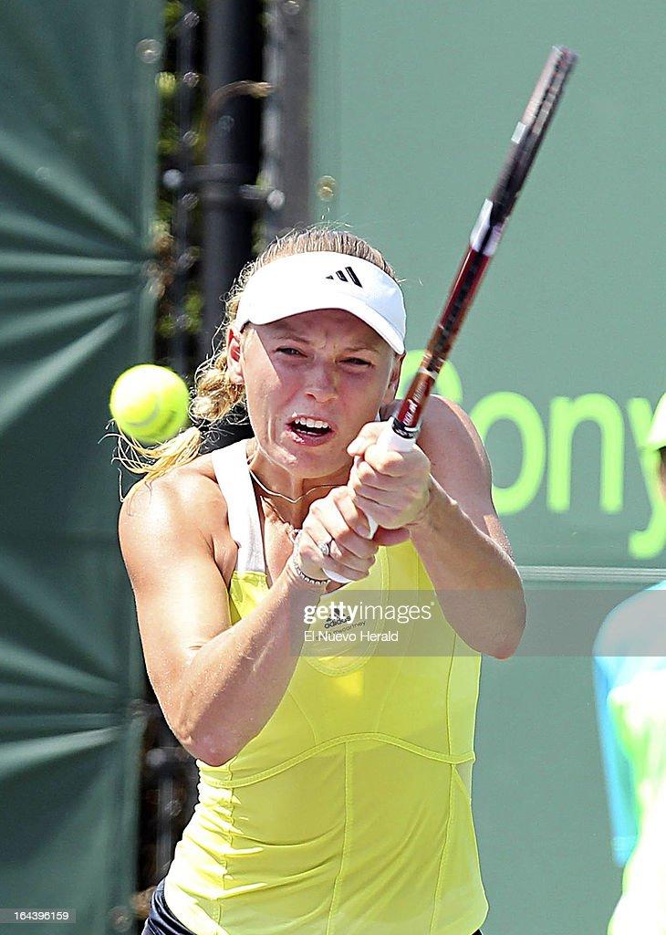 Caroline Wozniacki of Denmark returns a shot against Garbine Muguruza Blanco of Spain during a third-round match in the women's singles at the Sony Open Tennis in Key Biscayne, Florida, Florida, Saturday, March 23, 2013. Muguruza Blanco defeated Wozniacki, 6-2, 6-4.