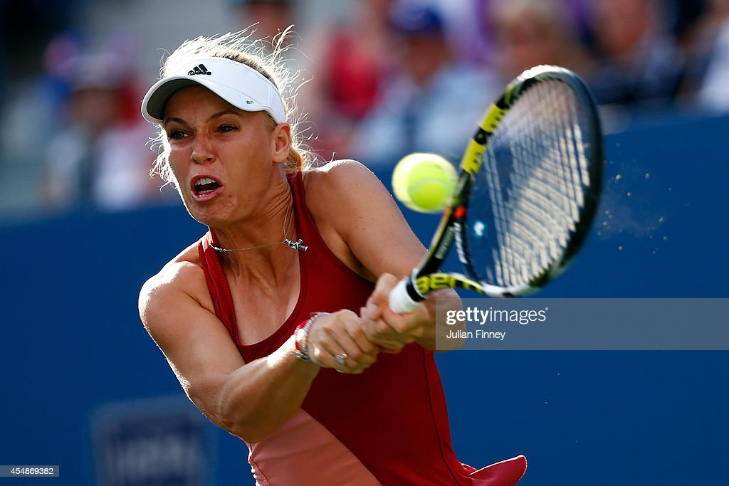 Caroline Wozniacki of Denmark returns a shot against Serena Williams of the United States during their women's singles final match on Day fourteen of...