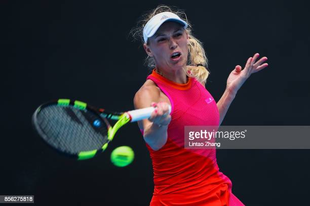 Caroline Wozniacki of Denmark returns a shot against Wang Qiang of China during the Women's singles first round match on day two of the 2017 China...