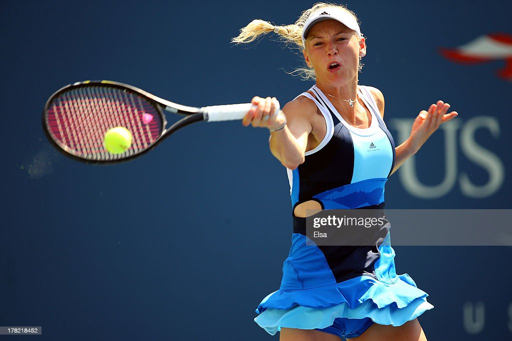 <a gi-track='captionPersonalityLinkClicked' href=/galleries/search?phrase=Caroline+Wozniacki&family=editorial&specificpeople=740679 ng-click='$event.stopPropagation()'>Caroline Wozniacki</a> of Denmark returns a shot during her women's singles first round match against Ying-Ying Duan of China on Day Two of the 2013 US Open at USTA Billie Jean King National Tennis Center on August 27, 2013 in the Flushing neighborhood of the Queens borough of New York City.
