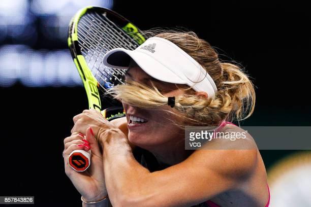 Caroline Wozniacki of Denmark returns a shot during the Women's singles thrid round match against Petra Kvitova of the Czech Repubic on day six of...