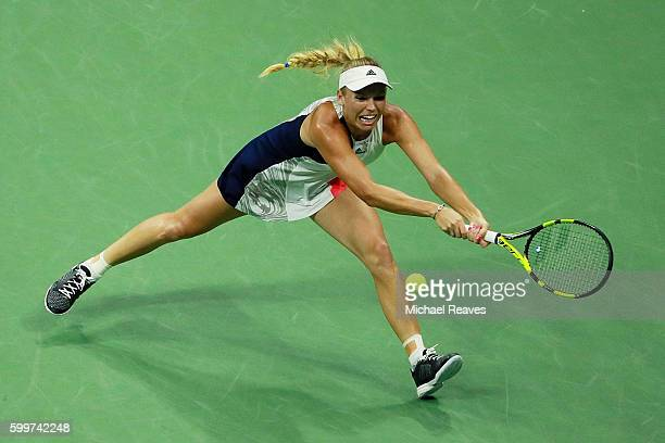 Caroline Wozniacki of Denmark returns a shot to Anastasija Sevastova of Lativa during their Women's Singles Quarterfinals match on Day Nine of the...
